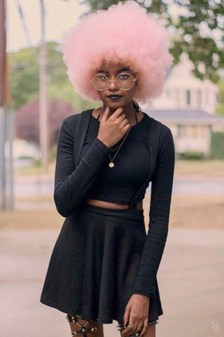 Black girl's natural hair dyed pink
