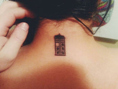 Dr. Who Tardis tattoo on the back of  a girl's neck