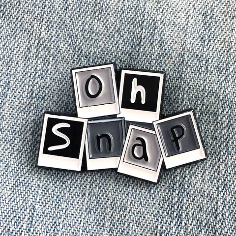 """Oh Snap"" photography themed enamel pin."