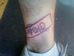 "name tattoo crossed out with a ""void"" stamp"