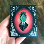 A spooky haunted house themed enamel pin of a vignette of a man with tentacles for his head.
