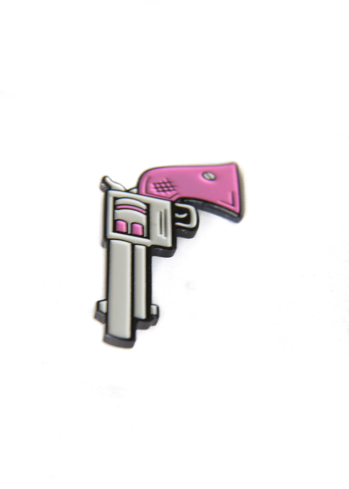 Enamel pin of a pink and silver gun