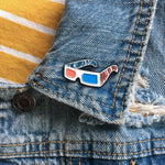 3D glasses enamel pin on the lapel of a jean jacket for trendy style. This is a unisex fashion accessory.