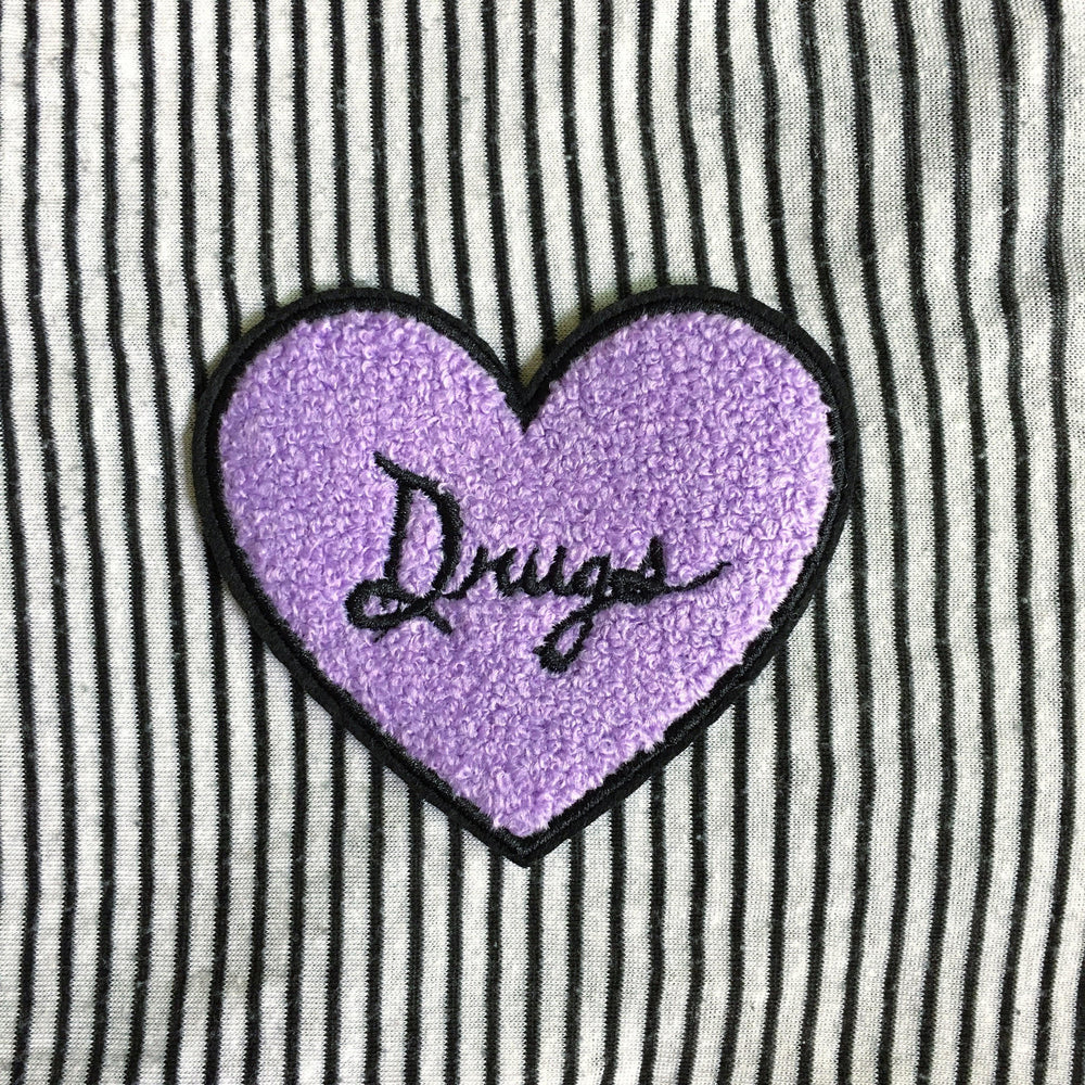 A spooky heart patch in lilac purple and black for women's alternative fashion.