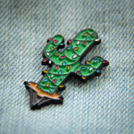 A festive lapel pin of a Christmas cactus for quirky western style.