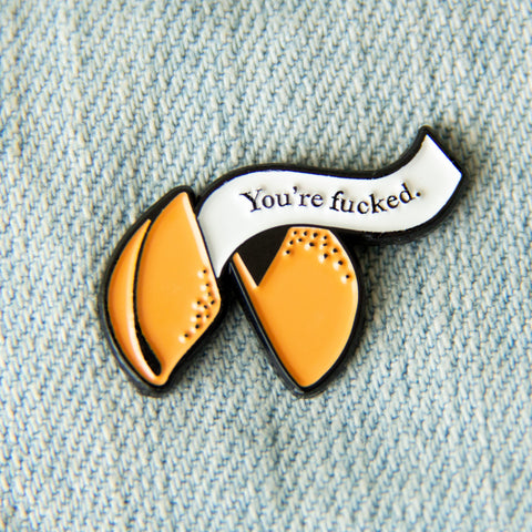 """You're Fucked"" fortune cookie enamel pin, by Ectogasm."