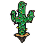 A cute lapel pin of a cactus plant decorated for Christmas. Artwork by Ectogasm.