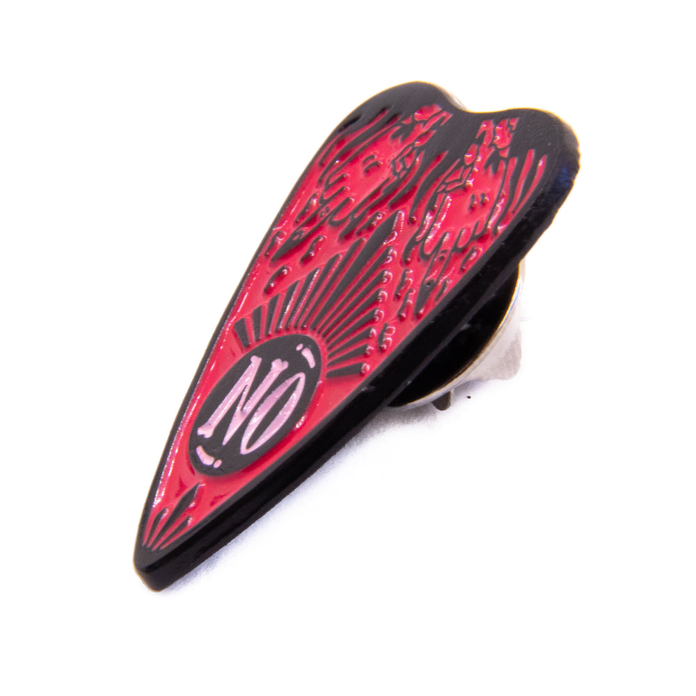 "A side view of a hot pink ouija planchette lapel pin that says, ""no""."