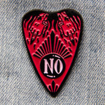 "A cool enamel pin for feminists. Features a hot pink ouija planchette with the quote, ""NO"", and witchy tattooed hands giving the middle finger. Pictured on a denim jacket."