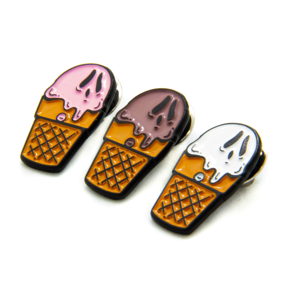 Colorful enamel pins of ice cream Sundays with ghost faces. Great for punk horror style.