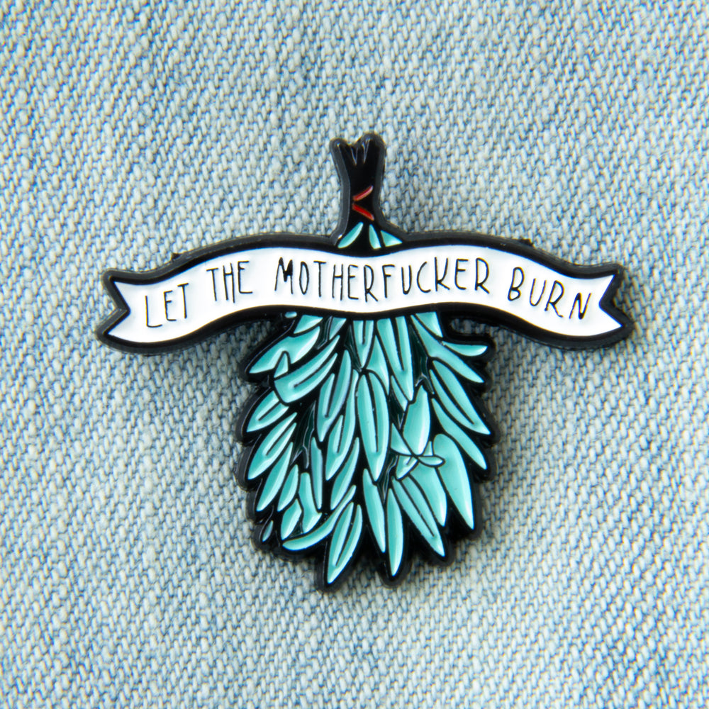 "A funny enamel pin for witchy aesthetic. Features a bundle of smudging sage with the quote, ""Let the motherfucker burn""."