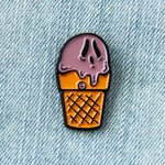 A unisex lapel pin of a chocolate ice-cream sunday with a ghosts face. Designed by Ectogasm.