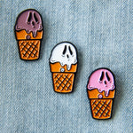 A cool enamel pin collection of Neapolitan ice-cream cones with spooky ghost faces. Great for summer goth fashion.