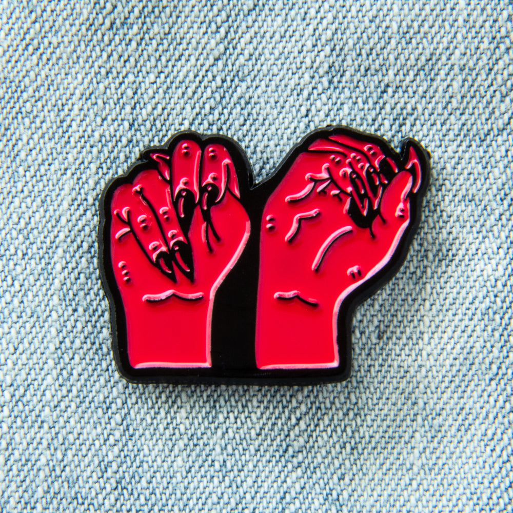 "A cool black and hot pink enamel pin of two witchy hands signing ""NO"" in ASL. Gift for feminists."