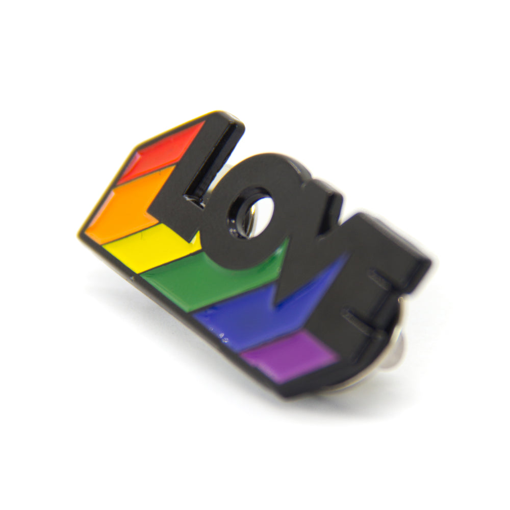 "A black and rainbow colored lapel pin of the word ""Love"" for gay pride."