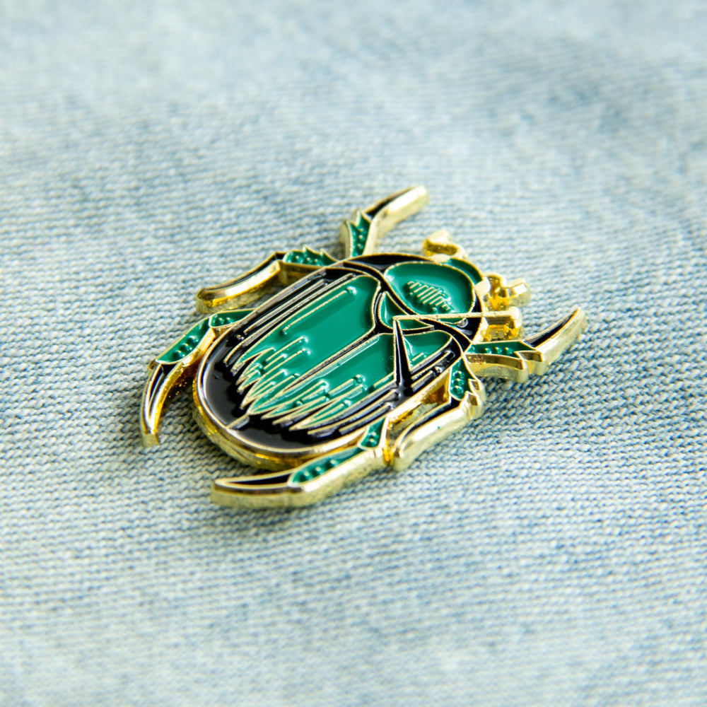 A beautiful, victorian style enamel pin of a beetle for entomologists.