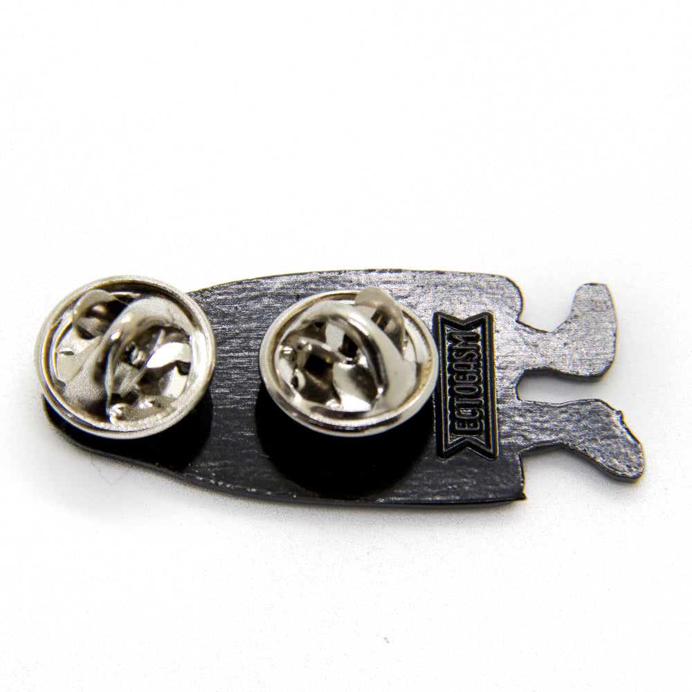 Two strong clasps on the back of a Halloween enamel pin, designed by artist Ectogasm.