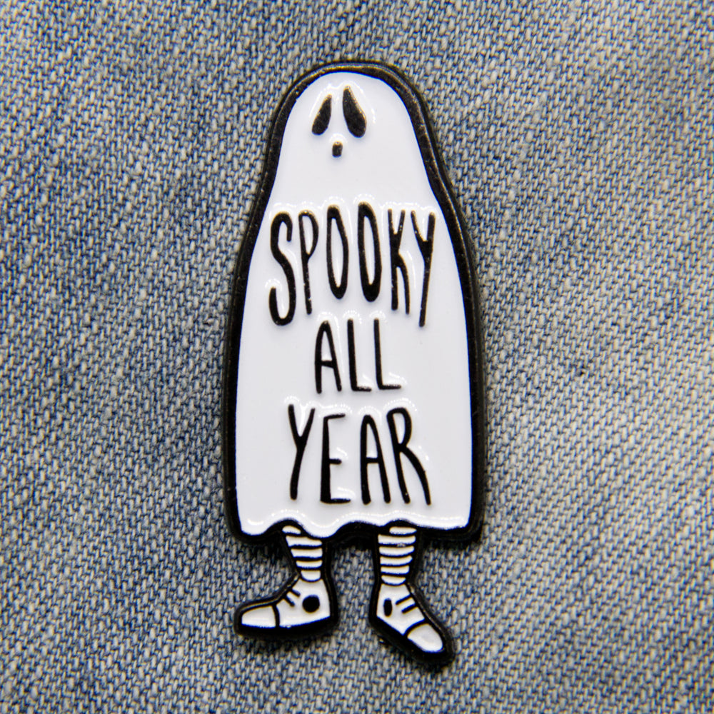 "A cool enamel pin of a ghost with the quote, ""Spooky All Year"" for goth fashion."