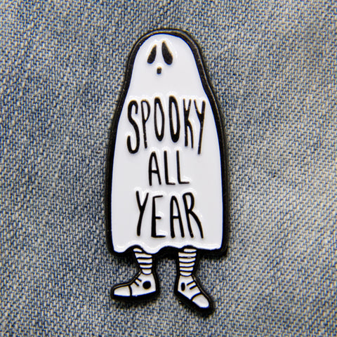 """Spooky All Year"" enamel pin of a ghost."