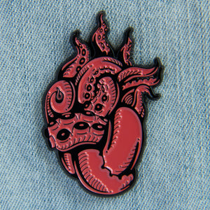 A cool, ocean themed enamel pin of tentacles shaped like a human heart.