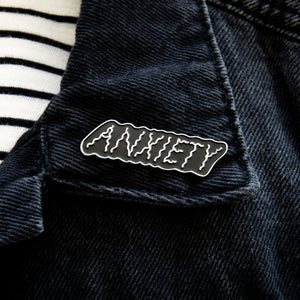 "Load image into Gallery viewer, A stylish lapel pin of the word ""Anxiety"" for men and women's fashion."