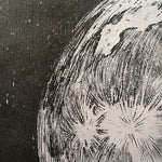 Detail on black and gray art print, made with ink.
