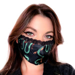 A cool face mask with a snake art print for women's witchy and alternative fashion.