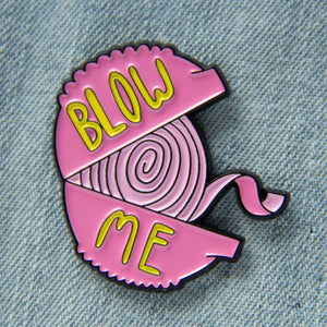 "A funny pink and yellow enamel pin of a bubblegum container with the quote, ""Blow Me""."