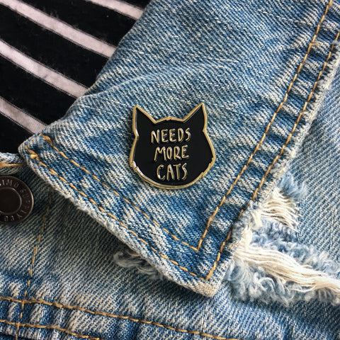 """Needs More Cats"" Black and Gold pin"