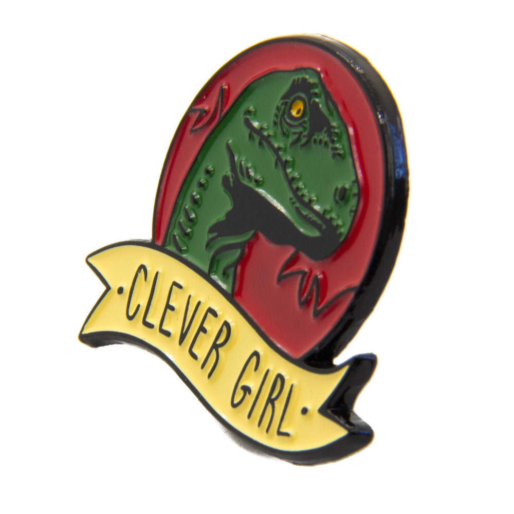 "A collectible enamel pin for a dinosaur movie fandom with the quote, ""Clever Girl""."
