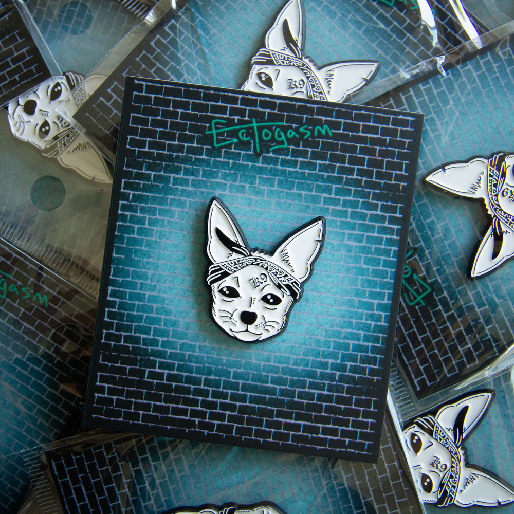 Cute rapper dog enamel pin for music fans.