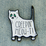 "A funny enamel pin of a ghost cat with the quote, ""Creeping meow-t""."