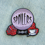 "A funny enamel pin of a crystal ball with the quote, ""Spoilers""."
