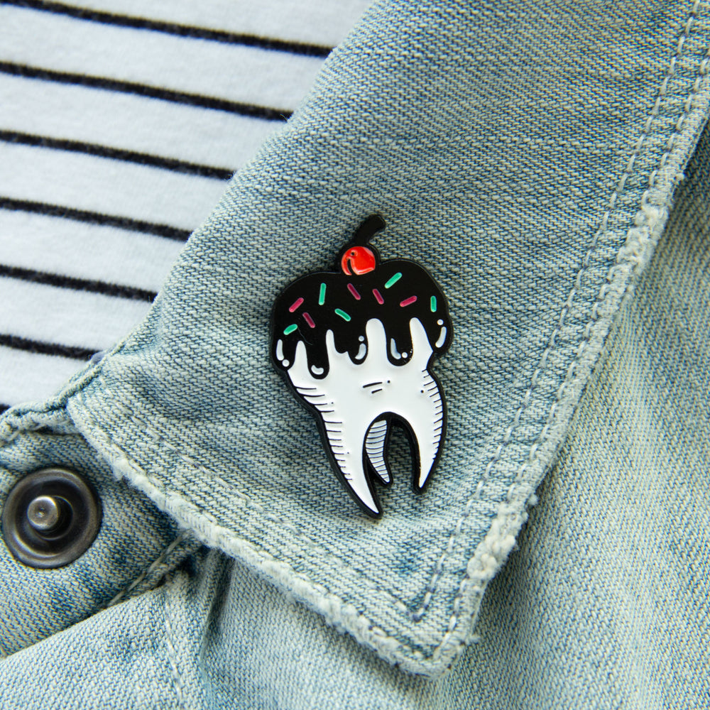A cute food pin for girls on the lapel of a denim jacket.