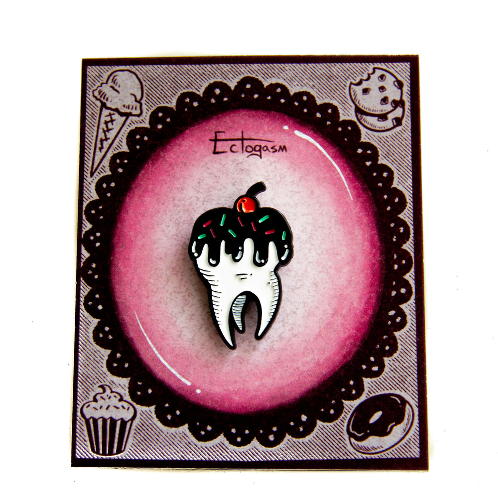 "A literal ""sweet tooth"" enamel pin for wholesale to bakeries and cafes."