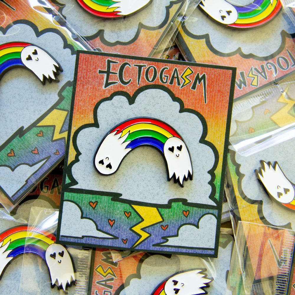 A creepy cute lapel pin of ghosts with heart eyes forming a rainbow.
