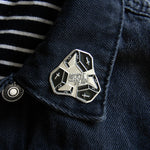 A spooky fashion accessory on the lapel of a unisex denim jacket.