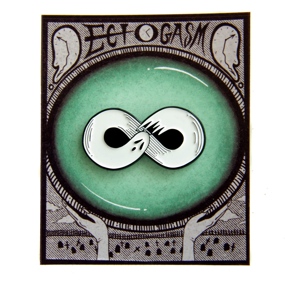 A ghost enamel pin on spooky packaging, designed by Ectogasm.