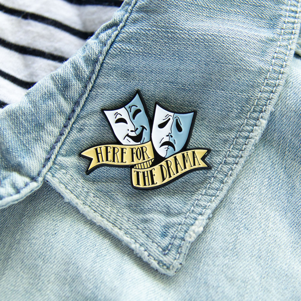 A funny enamel pin of comedy and tragedy masks for actors and playwrights.