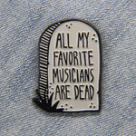 "An enamel pin of a tombstone with the quote, ""All My Favorite Musicians Are Dead""."