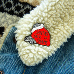 "A funny Christmas pin with the quote, ""Santa's Sack of Shame""."