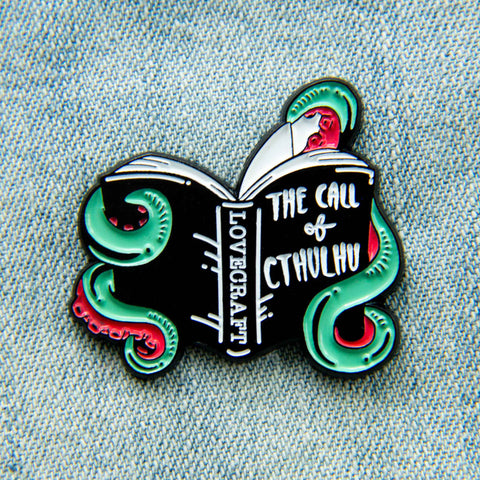 An HP Lovecraft book enamel pin.