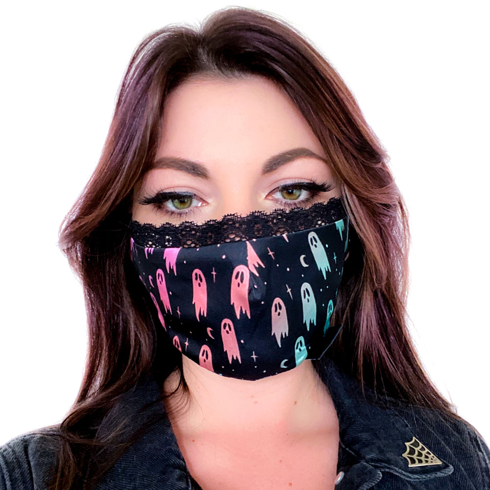 A cute, pastel goth fashion face mask of rainbow colored ghosts with a lace trim for women.