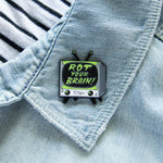 "A cool enamel pin of a retro TV set with the quote, ""Rot Your Brain"" for alternative and punk style."