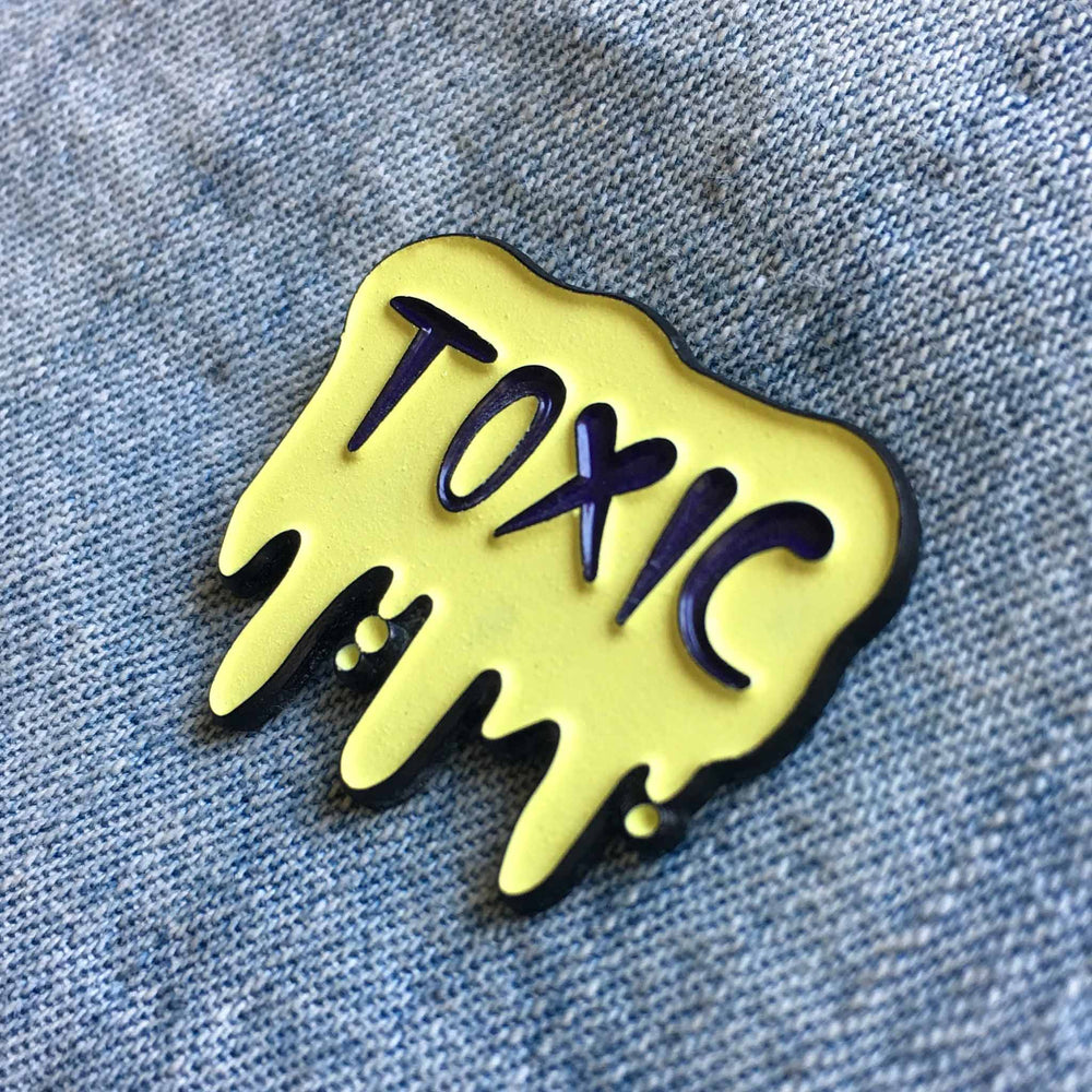 A cool glow-in-the-dark enamel pin for punk fashion.