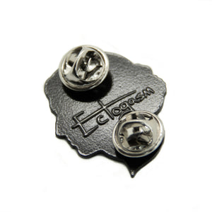 Metal clasps on the back of an Ectogasm book themed enamel pin.