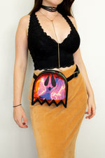 An outfit for festival fashion with a bralette, skirt, and gothic fanny pack.