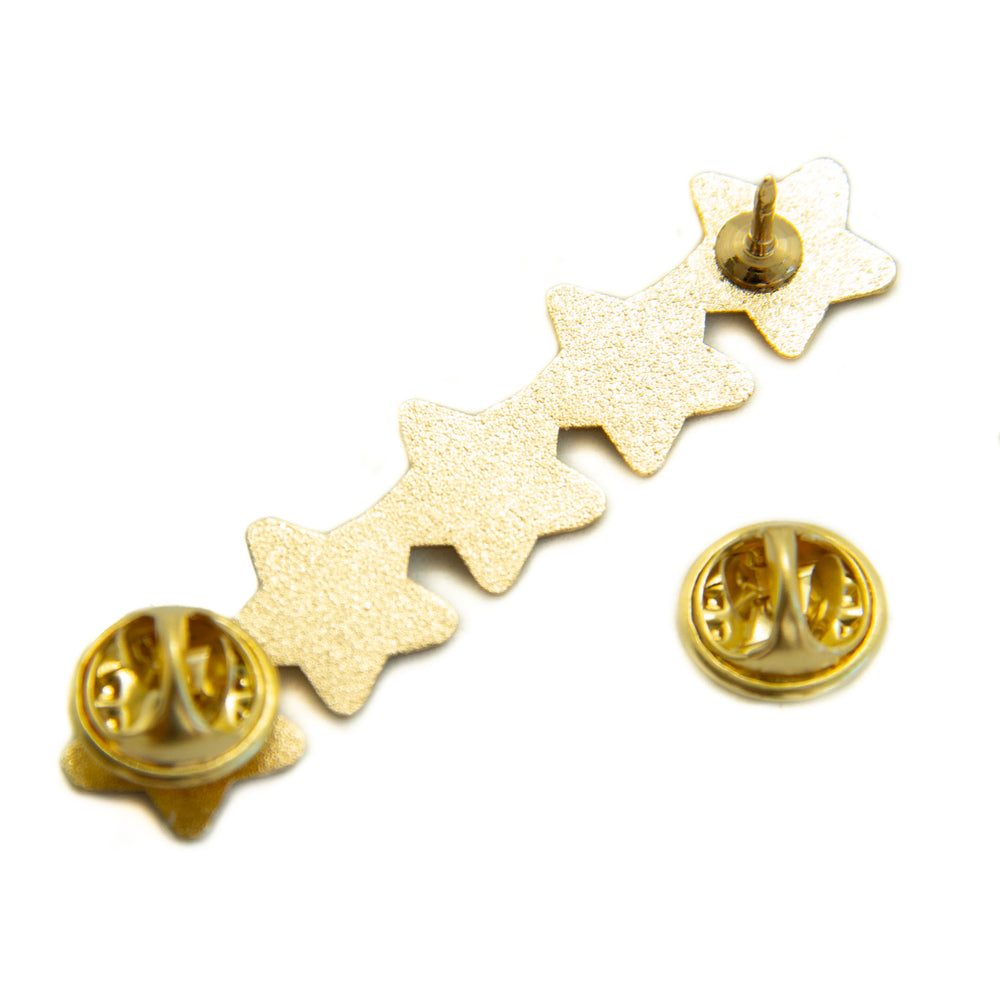 Two clasps on the back of a gold pin.