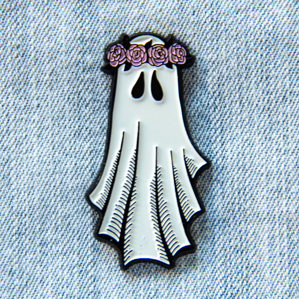 A cute enamel pin of a ghost wearing a pink flower crown for unique fashion.