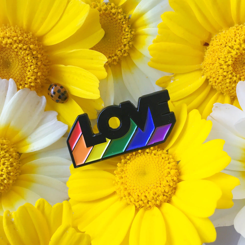 "A rainbow lapel pin of the word, ""Love"" for gay and lesbian couples."